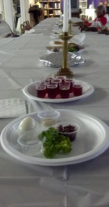 On the table, wine, bitter herb, lamb and boiled egg. Similar to a Jewish Passover meal, this represents Jesus' last supper with his disciples. For Christians, the Thursday before Easter Sunday is known as Maundy Thursday and usually ends with foot washing. Photo by: Reginald B. Johnson Sr., Pastor, Historic New Bethel A.M.E. Church, Ormond Beach, FL